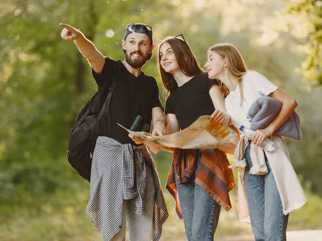 adventure-travel-tourism-hike-people-concept-group-smiling-friends-forest